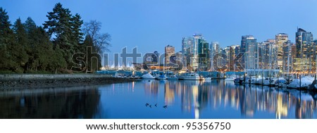 Vancouver BC Canada Skyline and Marina along False Creek from Stanley Park at Blue Hour Panorama - stock photo