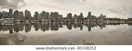 Vancouver BC Canada Waterfront Skyline Reflection from Stanley Park Panorama - stock photo