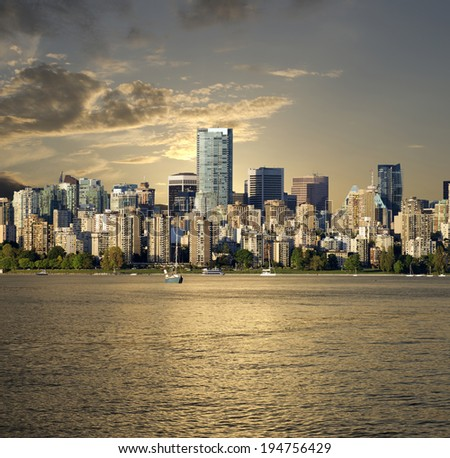 Vancouver, BC in golden light, panoramic view with English Bay (photo taken in summer 2014) - stock photo
