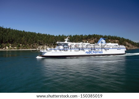 VANCOUVER,  BC - JULY 23: A BC ferry between Vancouver and Vancouver Island on July 26, 2013. BC Ferries announced plans to build three new vessels on July 23, 2013 - stock photo