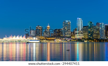 VANCOUVER, BC - JUNE 20, 2015 - Vancouver skylines with light reflection at blue hour. The view from Stanley Park. A colorful cityscapes. Panoramic style.