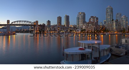 Vancouver BC skyline and the Burrard bridge at false Creek Canada. - stock photo