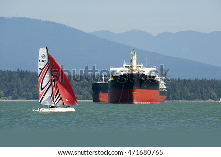 VANCOUVER BEACHES - AUG.20, 2016: Kitsilano and Spanish banks beachesare popular for Vancouver Residents. Beaches surround English Bay, which is also used for trans-oceanic ships waiting to be loaded.