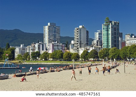 VANCOUVER BEACHES - JULY 7, 20106: The most popular Vancouver beach is English Bay Beach, located near downtown, some 50 metres  from West End's Denman Street. British Columbia, Canada