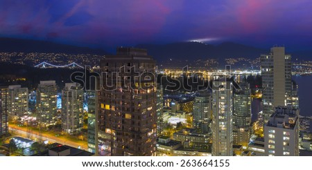 Vancouver British Columbia Canada Cityscape with Street Light Trails Stanley Park Grouse Mountain View at Dusk - stock photo
