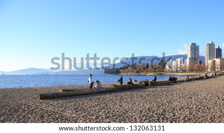 VANCOUVER, BRITISH COLUMBIA/CANADA - MARCH 8: Tourists gather at Sunset Beach on March 8, 2013 in Vancouver. The beach is located in downtown Vancouver, on the shores of English Bay. - stock photo