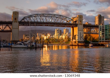 Vancouver - Burrard Bridge at sunset viewed from Granville Island - stock photo
