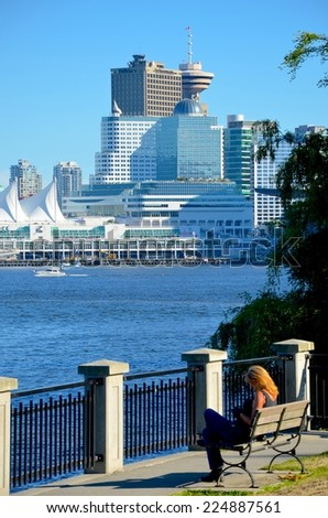 VANCOUVER, CA - JULY 27: Canada Place Harbor view from Stanley Park on July 27, 2014 in Vancouver, Canada. Famous Vancouver main cruise ship terminal, it was built in 1927. - stock photo