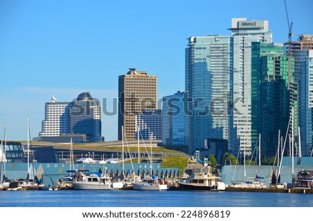 VANCOUVER, CA- JULY 27: Coal Harbor at Downtown Vancouver, and Lifestyle on July 27, 2014 in Vancouver, CA Vancouver has prominent buildings in a variety of styles by many famous architects.