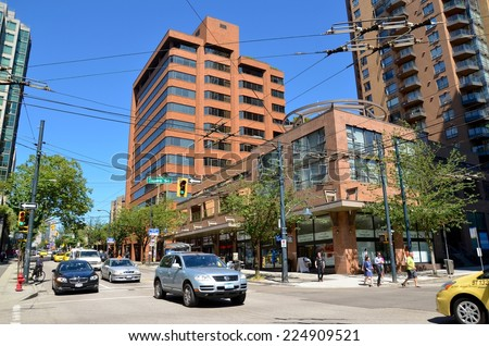 VANCOUVER, CA - JULY 27: Downtown Vancouver Modern Architecture, and Lifestyle on July 27 , 2014in Vancouver, CA. Vancouver has prominent buildings in a variety of styles by many famous architects - stock photo