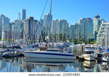 VANCOUVER, CA - JULY 27: Downtown Vancouver Waterfront Architecture, and Lifestyle on July 27, 2014 in Vancouver, CA. Vancouver has prominent buildings in a variety of styles by many famous architects