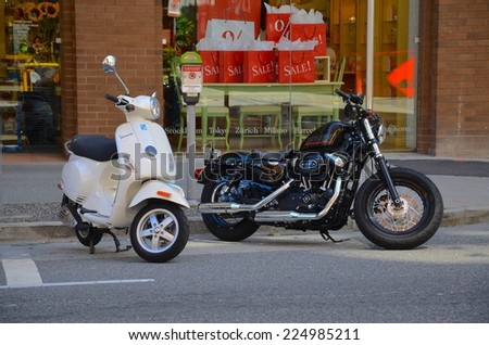 VANCOUVER,CA- JULY 27: Motorcycle at Vancouver Streets in Canada on July 27,2014. Vancouver has great accessibility for visitors, it is the third largest city in Canada. - stock photo