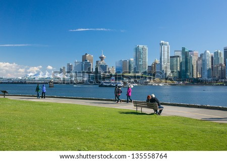 VANCOUVER, CANADA - APRIL 14: Unidentified people walk on seawall in Stanley Park on April 14, 2013. Seawall is 8.8-kilometer paved route that loops around the park.