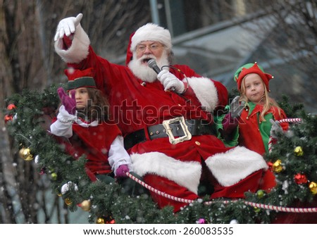 VANCOUVER, CANADA - DECEMBER 2, 2012: Thousands of participants and spectators took part in an annual The Santa Claus Parade in Vancouver, Canada, on December 2, 2012. - stock photo