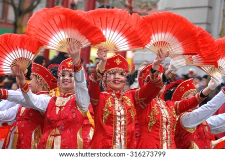 VANCOUVER, CANADA - FEBRUARY 17, 2013: Thousands of people took part in the Chinese New Year Parade and celebrations at Chinatown in Vancouver, Canada, Feb. 17, 2013.  - stock photo