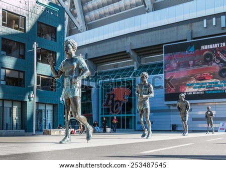 VANCOUVER, CANADA - FEBRUARY 15, 2015: Unidentified teenagers play near Terry Fox Monument in Downtown Vancouver. Terry Fox was Canadian athlete, humanitarian, and cancer research activist. - stock photo