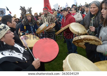 VANCOUVER, CANADA - JANUARY 5, 2013: Hundreds of aboriginal people rally in support of Idle No More movement protesting government treatment of First Nations groups in Vancouver, Canada, Jan.5, 2013. - stock photo