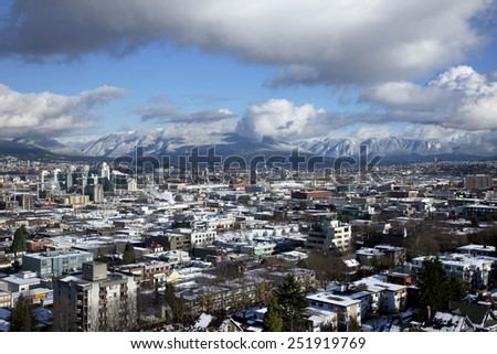 VANCOUVER, CANADA - JANUARY 2, 2009: Vancouver, the most popular city of British Columbia was the place of Winter Olympic Games 2010. Winter view of East Vancouver, Burnaby and Coast Mountains.
