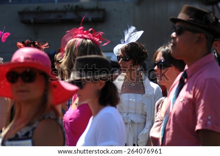 VANCOUVER, CANADA - JULY 26, 2014: A woman attends horse-racing derby in Vancouver, Canada, on July 26, 2014. - stock photo
