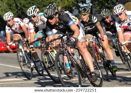 VANCOUVER, CANADA - JULY 11, 2014: Athletes compete during the BC Superweek bicycle race in Vancouver, Canada, on July 11, 2013. - stock photo