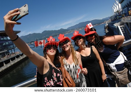 VANCOUVER, CANADA - JULY 1, 2013: Thousands of people gathered in downtown to take part in Canada Day celebrations in Vancouver, Canada, on July 1, 2013. - stock photo