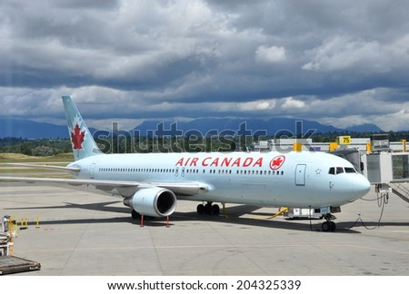 Vancouver, Canada - June 30, 2014: Air Canada plane seen parked at the tarmac of Vancouver International Airport. - stock photo
