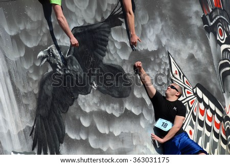 VANCOUVER, CANADA - MARCH 25, 2012: Students participate in the annual Storm The Wall fitness challenge at University of British Columbia in Vancouver, Canada, March 25, 2012.