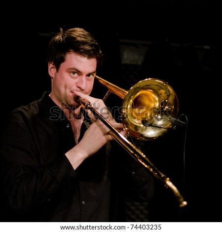 VANCOUVER, CANADA - MARCH 27: Trio Starbirds. Nick La Riviere on the stage of The Jazz Cellar on March 27, 2011 in Vancouver, Canada. - stock photo