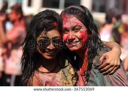 VANCOUVER, CANADA - MARCH 30, 2013: University of British Columbia students sing and throw colored powder during the annual Holi, the Indian Festival of Colors, in Vancouver, Canada, Mar.30, 2013.  - stock photo