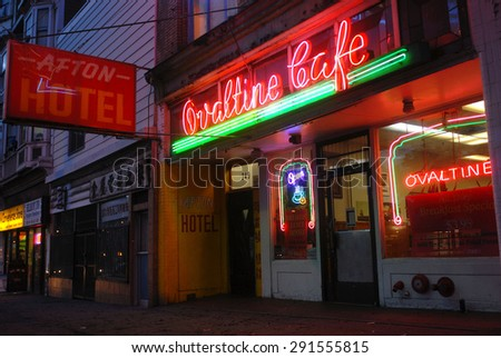 VANCOUVER, CANADA - MAY 2, 2012: A photograph of vintage neon sign still shining in Vancouver's Downtown, one of only handful remaining original neon signs in Vancouver, Canada, May 2, 2012.