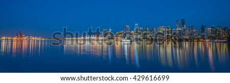 Vancouver,Canada,May 30 2016. colorful downtown Vancouver in blue evening at Stanley park