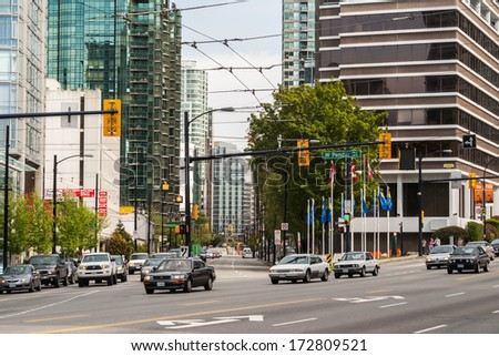 VANCOUVER, CANADA - MAY 12, 2007: Intersection of West Pender and Georgia in downtown. Georgia St. is one of primary streets in business district connecting Vancouver with North Shore.