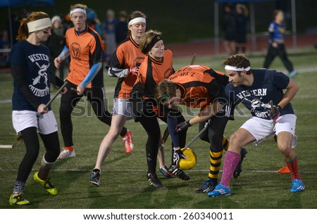 VANCOUVER, CANADA - NOVEMBER 22, 2014: University teams play quidditch, the game of Harry Potter books fame, at Simon Fraser University in Burnaby, BC, Canada, on November 22, 2014.