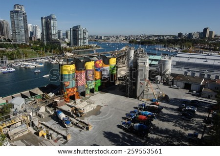VANCOUVER, CANADA - SEPTEMBER 5, 2014: Internationally renowned Brazil artists OSGEMEOS completed the creation of their world's biggest urban mural in Vancouver, Canada, on September 5, 2014.