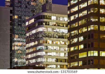 Vancouver cityscape at night. Colorful city night with skyscrapers, highrise buildings. - stock photo