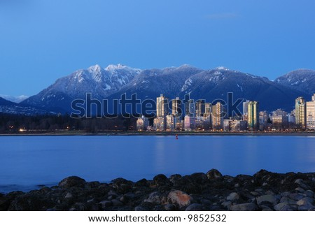 vancouver cityscape with grouse mountain background - stock photo