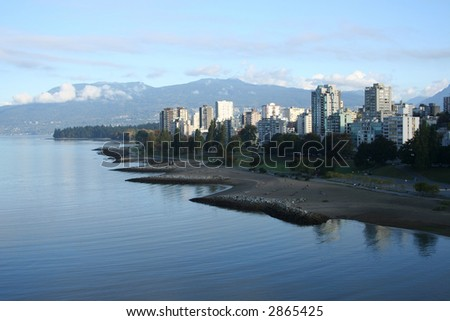Vancouver condominiums Stanley Park and mountains - stock photo