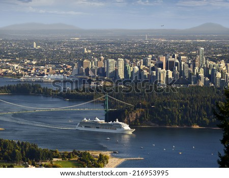 Vancouver - Cruise ship leaving Burrard Inlet (with Stanley Park, Lions Gate Bridge and the plane on the horizon), British Columbia, Canada - stock photo