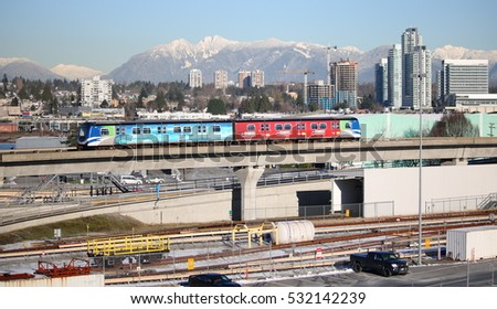 VANCOUVER - DECEMBER 7, 2016: A Canada Line train travels through the city of Vancouver, British Columbia on December 7, 2016.