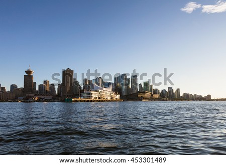 Vancouver Downtown, BC, Canada, City Skyline. Picture taken from water during sunset.