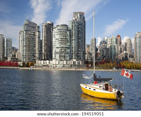 Vancouver - False Creek with modern buildings and a sail - stock photo