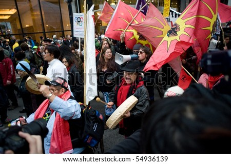 VANCOUVER - FEB 12: Protesters on Georgia Street protesting the Vancouver 2010 Olympics preparing to march to the site of the opening ceremonies February 12, 2010 in Vancouver, Canada. - stock photo