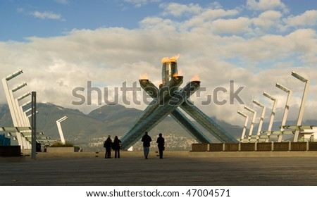 VANCOUVER - FEBRUARY 16: The Olympic Torch burns in the city of Vancouver as it hosts the 2010 winter games, February, 16, 2010. - stock photo