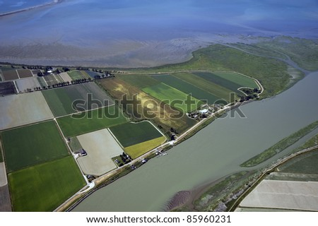 Vancouver - fields in Richmond by the sea and Fraser River - stock photo