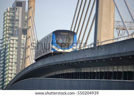 VANCOUVER - JANUARY 5, 2016: A young passenger enjoys the view as Vancouver's Skytrain crosses over a Skybridge in Vancouver on January 5, 2016.