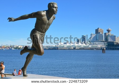 VANCOUVER - JULY 27: Harry Jerome Monument at Stanley Park on July 27, 2014 in Vancouver Canada.He set seven world records, run 100 meters in 10.0 sec. in 1960. Bronze medal in 1964 Olympic games - stock photo