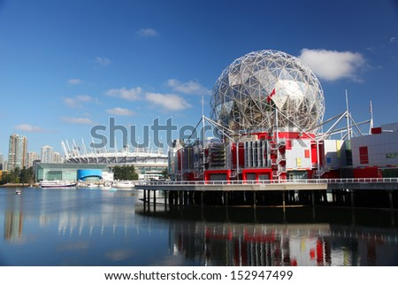 VANCOUVER - JULY 2: Science World and BC Place Stadium in Vancouver, Canada on July 2, 2013. Vancouver has been ranked the third most liveable city in the world for the second year in a row.  - stock photo