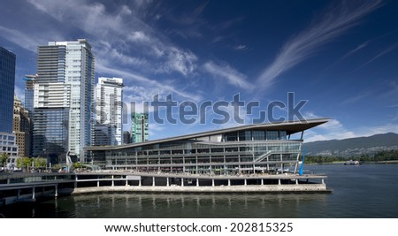 VANCOUVER - JULY 1, 2014: The West Building of Vancouver Convention Centre was open 2009. Surrounding the building are walkways, bikeways, plazas and parks. East Building is located in Canada Place.  - stock photo