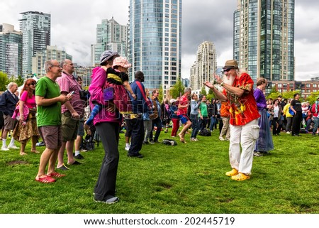 VANCOUVER-JUN 28, 2014: Audience at the 29th Annual Vancouver Jazz Festival at downtown David Lam Park, enjoying the performance of Lorraine Klaasen, a South African singer based in Montreal. - stock photo
