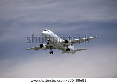 VANCOUVER - JUNE 7, 2014: Air Canada is the flag carier and largest airline of Canada. Airbus A320, one of compan's aircrafts was photographed before landing on Vancouver International Airport, B.C. - stock photo